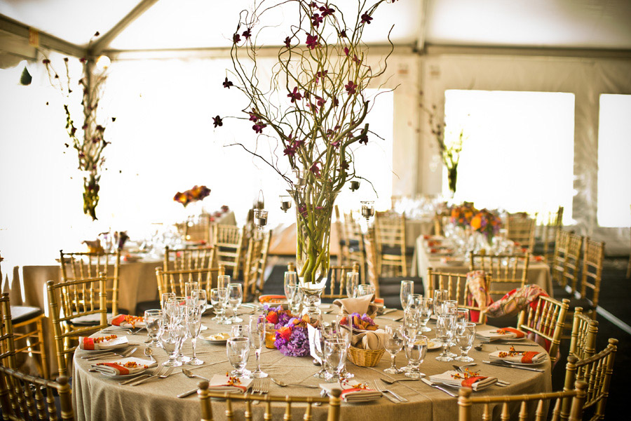 Tall centerpiece of manzanita branches and orchids