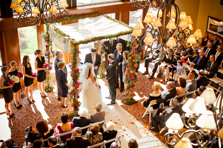 Autumn chuppah with bold flowers and cheer white draping