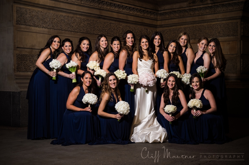 navy blue bridesmaids dresses and white bouquets